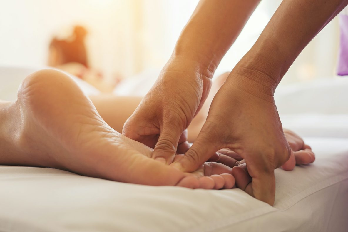 reflexology treatment on patient foot by our professionals