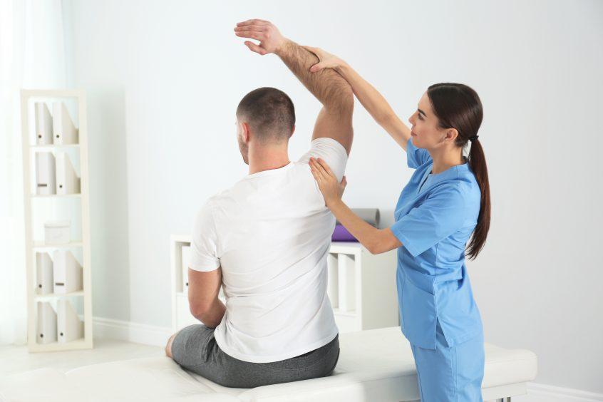 visual image of doctor working with patient in hospital